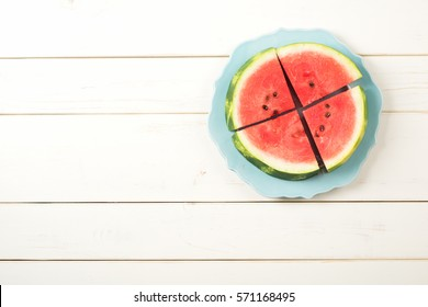 Sliced Sweet Red Watermelon Pieces on a Teal Plate on side of White Rustic Wood Background or Table with room or space for text, copy, or your words.  Grown in Hermiston, Oregon, United States