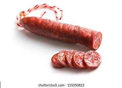 sliced tasty chorizo sausage on white background