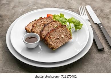 Sliced tasty turkey meatloaf served for dinner on table
