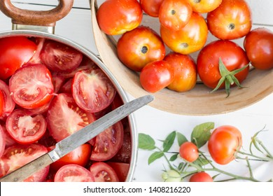 Sliced tomatoes in the pot, tomatoes are prepared for preserves, cooking and food concept, top view
