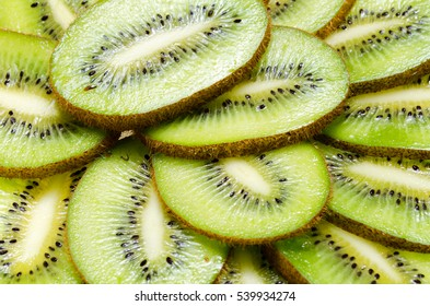 sliced tropical fruit kiwi closeup on a white background