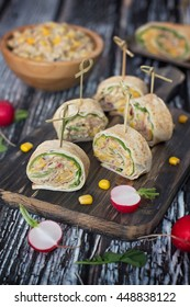 Sliced tuna wraps with tortilla and corn