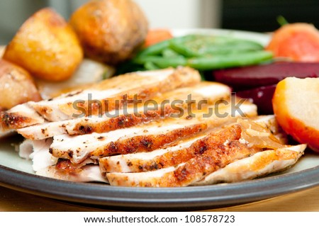 sliced turkey with roasted potatoes, sugar beets, yams and green beans perfect for Christmas dinner and Thanksgiving meals
