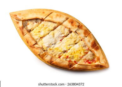 Sliced Turkish Pide on a wooden plate. Traditional Turkish pizza. Healthy dinner