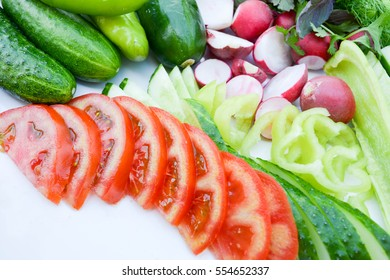 Sliced vegetables, background, cucumber, tomato