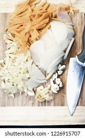 Sliced vegetables on the cutting board. Overhead vertical shot