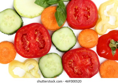 Sliced vegetables on a white isolated background
