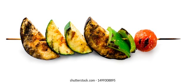 Sliced vegetables on wooden pick isolated on white, grilled vegetables on a skewer