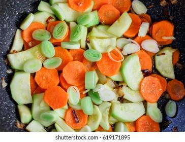 Sliced vegetables in pot. Preparing healthy vegetarian meal.