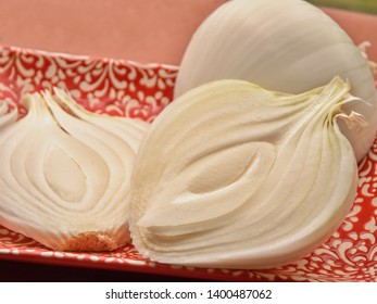 Sliced very large spring onion with well visible structure in close-up, on a plate, three parts