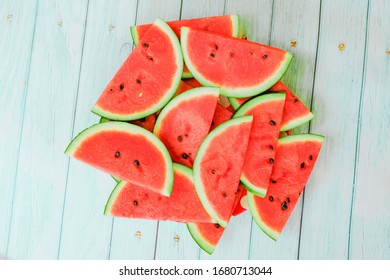 sliced watermelon on blue wooden background with copy space
