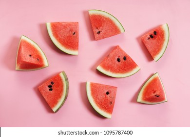 Sliced watermelon on pink background, top view