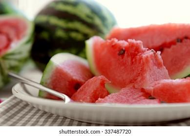 Sliced watermelon on plate closeup