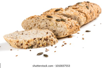 Sliced whole grain multigrain bread  include edible seeds such as poppy, millet,  flaxseed,  pumpkin seeds, and sunflower seeds isolated on white background.