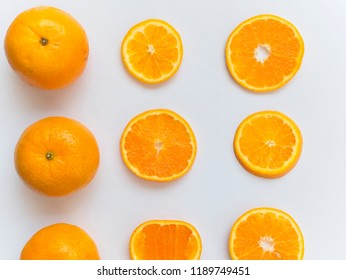 Sliced and whole orange on white background and arranged around of frame