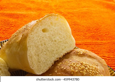 sliced whole wheat breads on the textile orange background