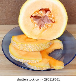Sliced yellow melon on the wood kitchen background. Healthy food. Summer fruits