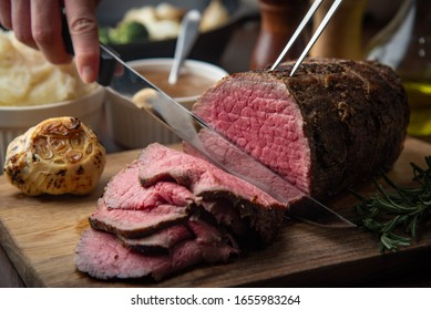 sliceing roasted eye of round beef with knife