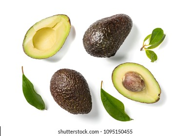 Slices of avocado on white background. Whole and half with leaves. Design element for product label