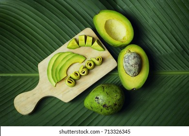 The Slices of Avocados on Banana Leaf Background