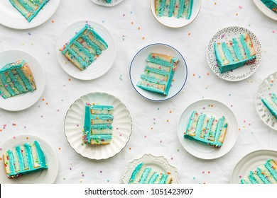 Slices of birthday layer cake overhead view