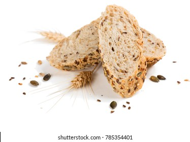 Slices of bread with different seeds ( pumpkin,  poppy, flax, sunflower, sesame,  millet ) decorated with wheat ears isolated on white background.