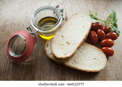 slices of bread, olive oil in a jar and cherry tomatoes 2