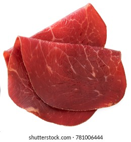 Slices of bresaola, cured beef, isolated on a white background