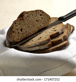 Slices of brown bred with a knife