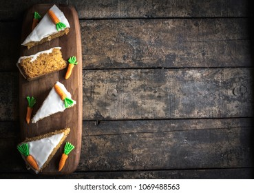 Slices of carrot cakes on the wooden background,selective focus and blank space