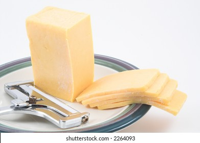 Slices of Cheddar Cheese and a Cheese Slicer