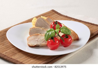 Slices of chicken breast fillet and mashed potato