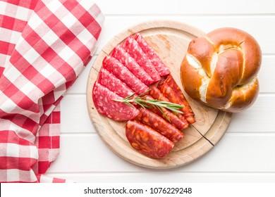 Slices of chorizo salami sausage on cutting board.