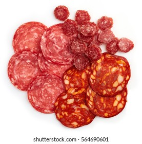Slices of chorizo sausage and salami isolated on white background. From top view