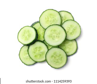 Slices of cucumbers on white background, top view