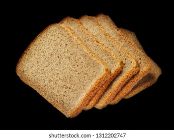 Slices of dark bread isolated over black background