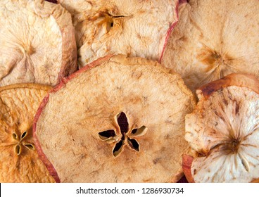 Slices of dried apple as a background. Closeup image