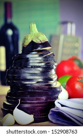 Slices of eggplant with garlic and bottle of wine