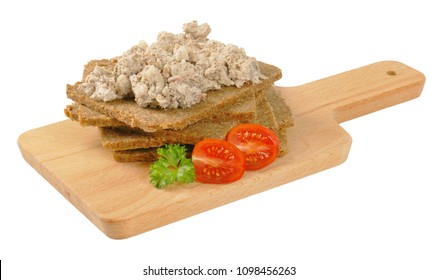 slices of fitness bread with fish spread on wooden cutting board