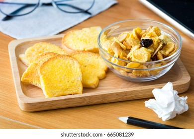 slices of fresh baked bread,bread crisp with corn flakes on desk