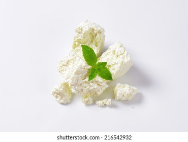 slices of fresh cheese on white background