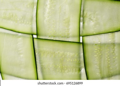 Slices of fresh Courgette on white background