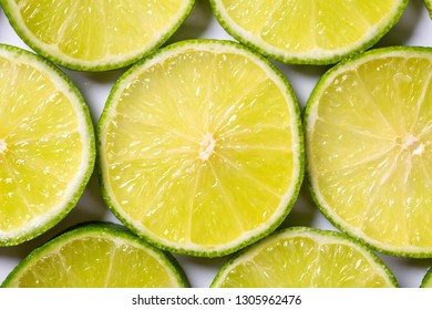A slices of fresh juicy green lemons. Texture background, pattern.