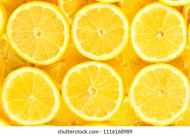A slices of fresh juicy yellow lemons.  Texture background, pattern