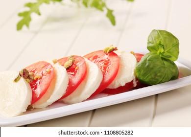 Slices of fresh mozzarella cheese and tomato