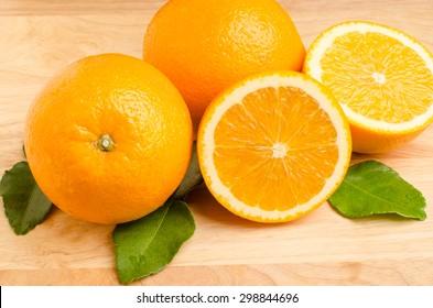 Slices of fresh Navel orange fruit on wooden background,healthy food
