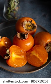 Slices of fresh persimmon. Autumn still life of fresh kaki.