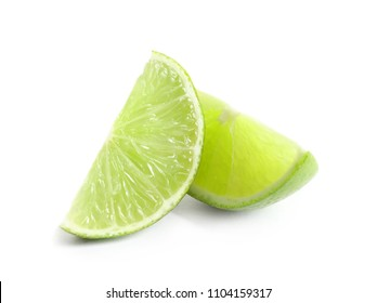 Slices of fresh ripe lime on white background