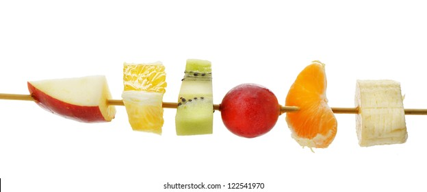 Slices of fruit on a wooden stick. A detailed photo on a white background