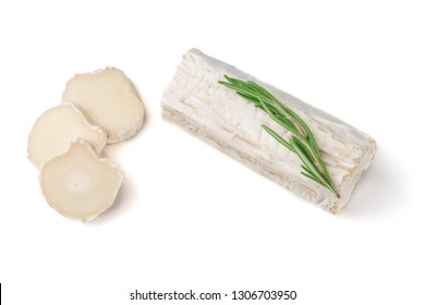 Slices goat cheese and goat cheese piece with rosemary isolated  on white background. Culinary cheese eating.
